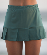 Image Pleated Tennis Skirt with Built In Compression Shorts Featured in Deep Emerald